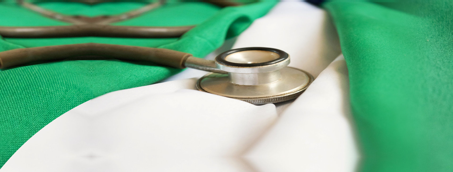 stethoscope on green towel